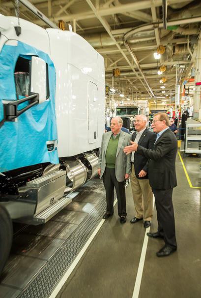 """From left: T. Boone Pickens, Founder, BP Capital; Stephen Silverman, Chief Operating Officer, Raven Transport; W.M. """"Rusty"""" Rush, CEO and President, Rush Enterprises, observing the new Raven LNG trucks at the Peterbilt Motors assembly plant in Denton, Texas."""